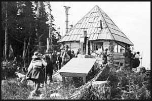 Men and women entering forestry lookout