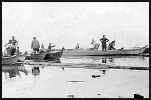 Mountaineers embarking in Indian canoes on Lake Quinault