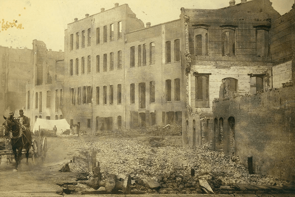 Aftermath of the fire of June 6, 1889, showing the ruins of buildings along 1st Ave. from Columbia to Yesler, Seattle, Washington