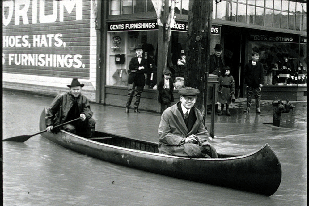 Photo of canoeing down flooded Kent street, 1906