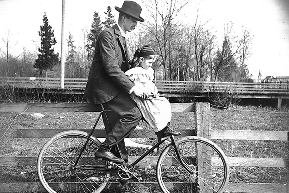 H. Ambrose Kiehl and his daughter, Laura Kiehl, on a bicycle, Washington, 1896