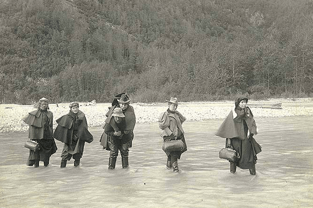 Actresses fording Dyea River on the Chilkoot Trail, Alaska, 1897