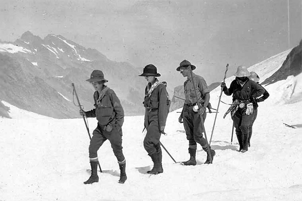 Men and women in snow during ascent of Mount Olympus, August 11, 1920