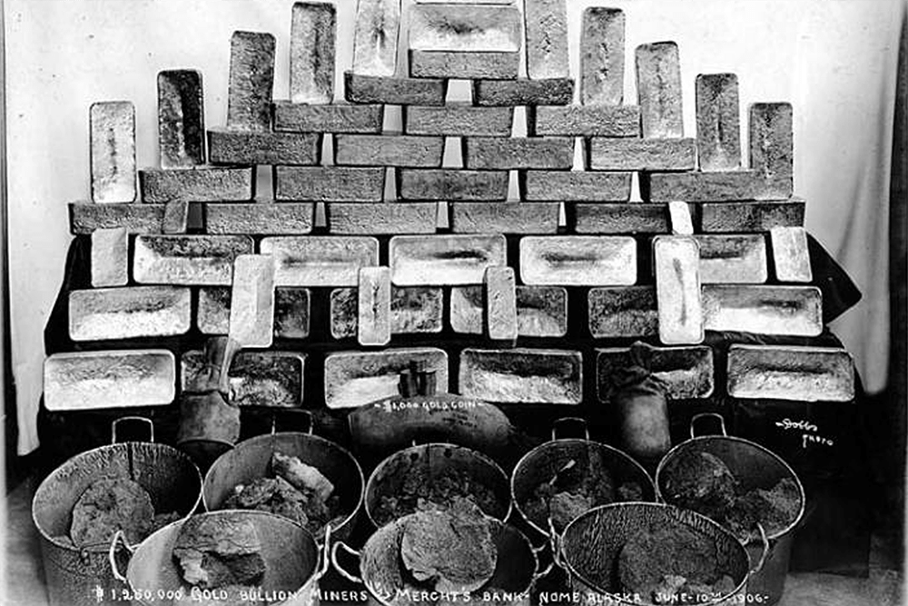 Gold bricks and buckets of gold ore belonging to the Miner's and Merchant's Bank, Nome, June 10, 1906
