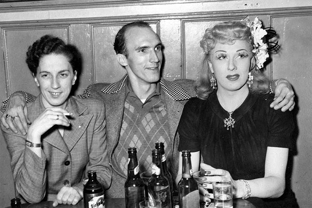 A blonde Jackie Starr with a man and a woman sitting at a table, probably Seattle, ca. 1946