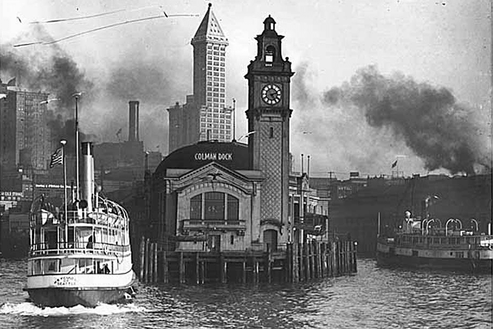 Colman Dock, L.C. Smith Building and nearby waterfront from Elliott Bay, Seattle, n.d.