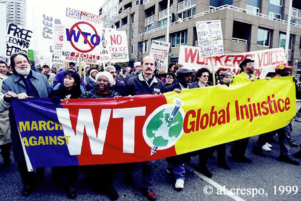 WTO protest banner, photograph by Al Crespo, 1999